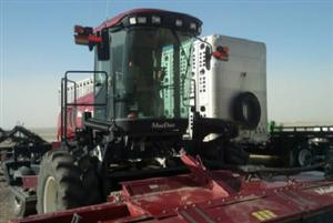Photo 1. MacDon M205 windrower