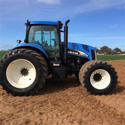 Photo 1. NEW HOLLAND TG285 tractor
