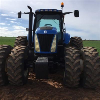 Photo 2. NEW HOLLAND TG285 tractor