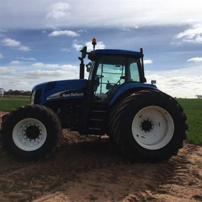 Photo 3. NEW HOLLAND TG285 tractor