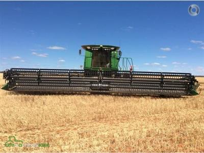 Photo 4. Midwest CH41CTF harvester front