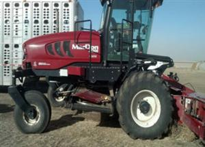 Photo 2. MacDon M205 windrower
