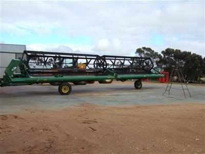 Photo 2. Macdon 590 Trailed Pto Windrower